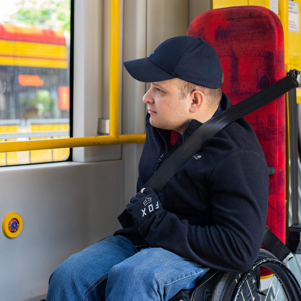 a wheelchair user seated in the correct position in the vehicle and wearing a seat belt