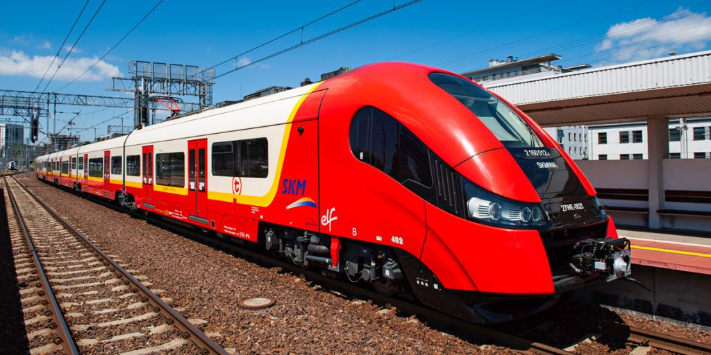 SKM train in red, cream and yellow colours