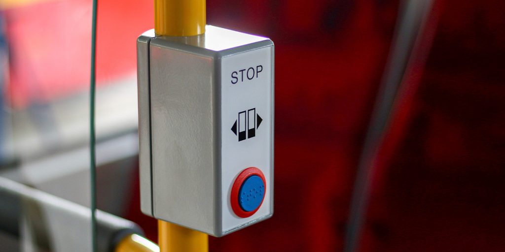 STOP button and door opening button, additionally marked in Braille