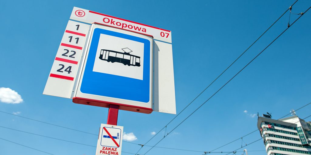 a stop post with a tram road sign, WTP logo, the name and number of the stand and a list of lines that stop at it